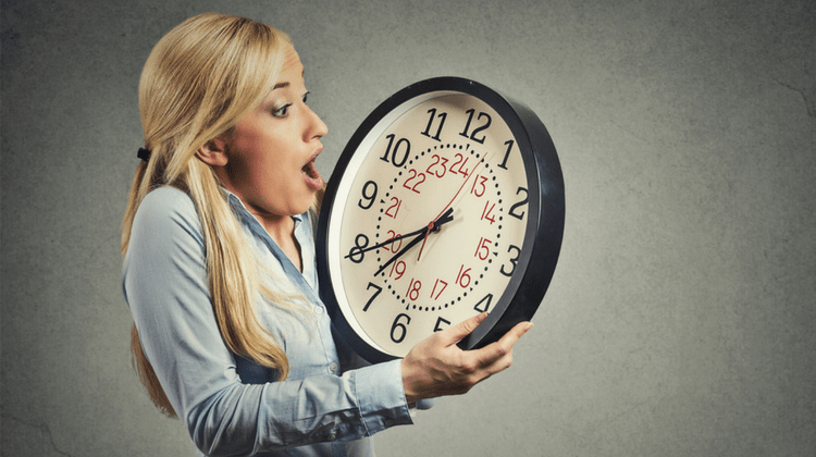 girl holding a clock is surprised with the time