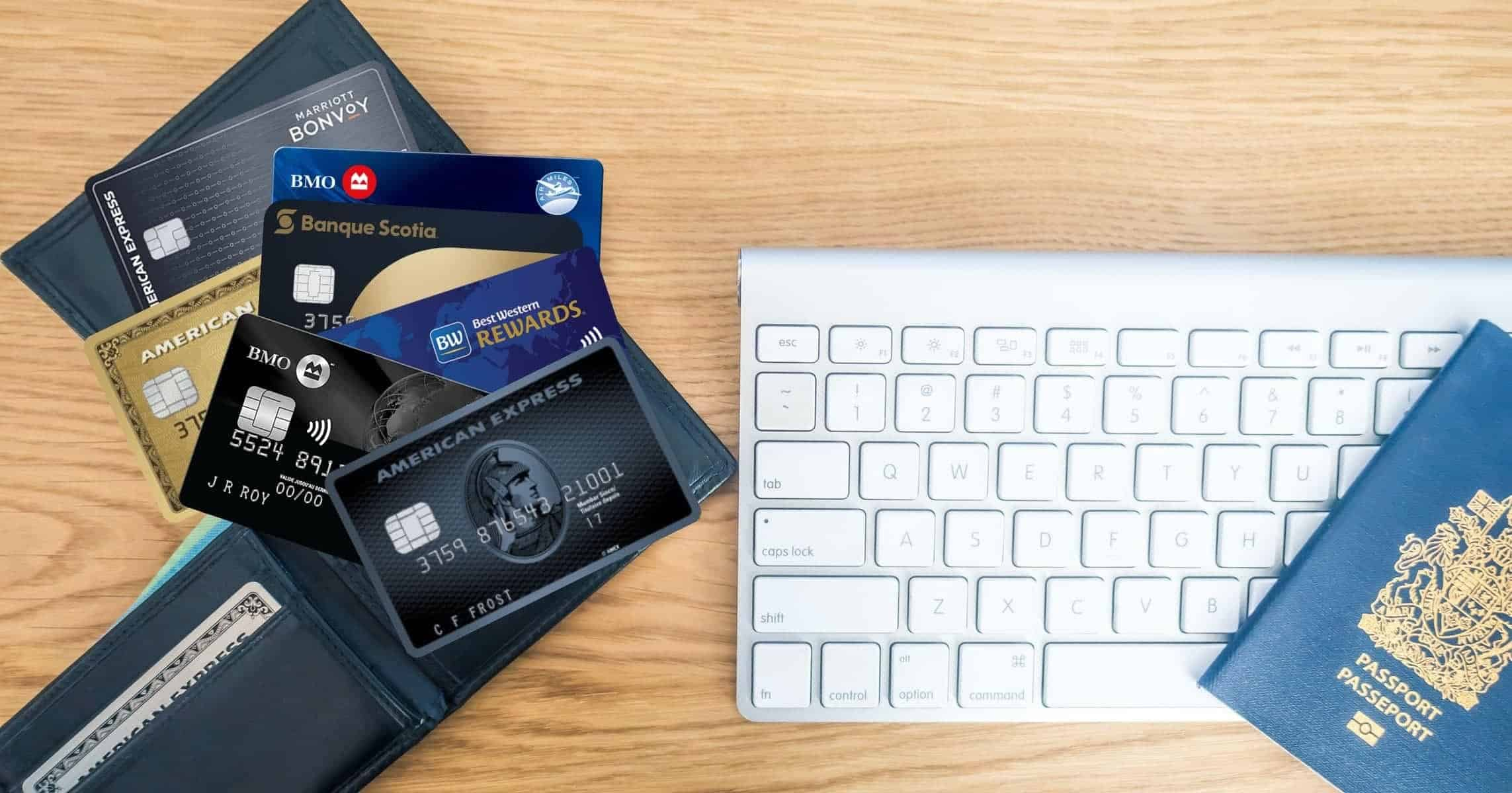 credit cards on the table along with keyboard and passport